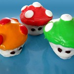 A variety of Super Mario Brothers Mushroom cupcakes