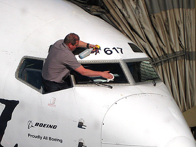 Guy cleaning the jets windshield - something I do not see every day!