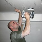 Jared screwing the sheetrock into place