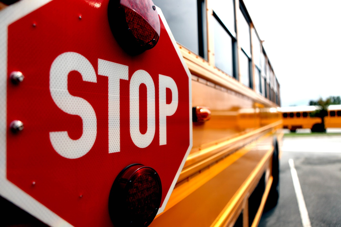 According to Base Order 5560.2N, no vehicle is to pass a school bus that is stopped, or in the process of stopping, to pick up or drop off children. Breaking this order will cost a driver a 90-day driving suspension on base.